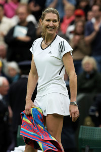 "LONDON, ENGLAND - MAY 17:  Steffi Graf looks on during the Ladies Singles match against Kim Clijsters during the ""Centre Court Celebration"" at Wimbledon on May 17, 2009 in London, England.  (Photo by Hamish Blair/Getty Images)"