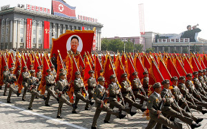 North Korean troops march past a portrait of the late leader Kim Jong Il during a military parade at Kim Il Sung Square to mark the 65th anniversary of the country's founding in Pyongyang, North Korea, Monday, Sept. 9, 2013. (AP Photo/Kim Kwang Hyon)